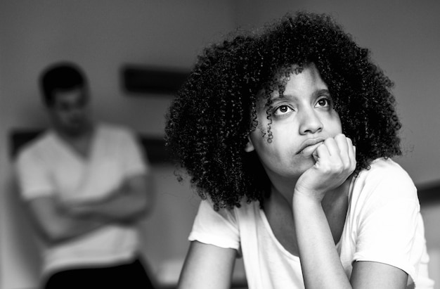 Sad afro woman in bad relationship.