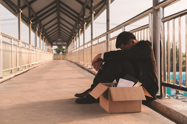 Sad asian businessman losing job