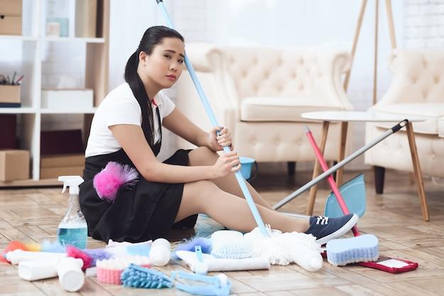 Sad asian housekeeper tired hard work concept