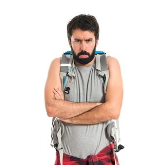 Sad backpacker over isolated white background
