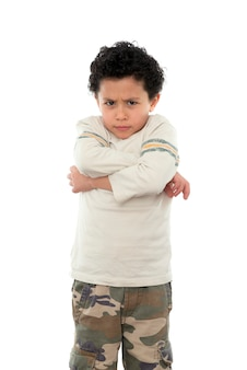Sad boy expressing anger isolated on white