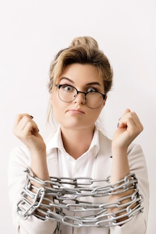 Sad business woman tied up with a chains. concepts of bankruptcy and debt.