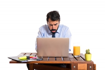Sad businessman in his office