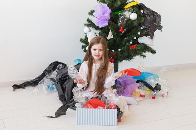 Sad child carrier box with plastic trash