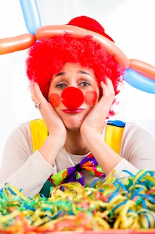 Sad clown being sick and tired of it all