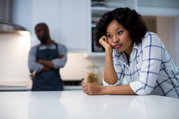 Sad couple in kitchen