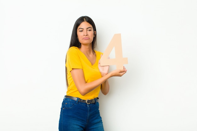 Sad, depressed, unhappy, holding a number 4.