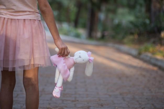Sad girl holding teddy bear