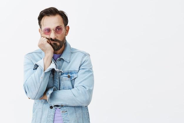 Sad and gloomy bearded mature man posing
