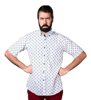 Sad handsome brunette man with beard