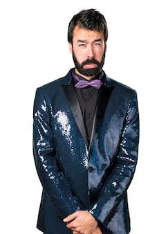 Sad handsome man with sequin jacket