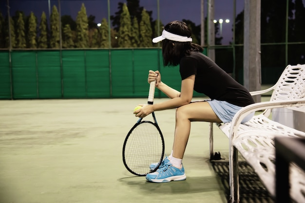 Sad lady tennis player