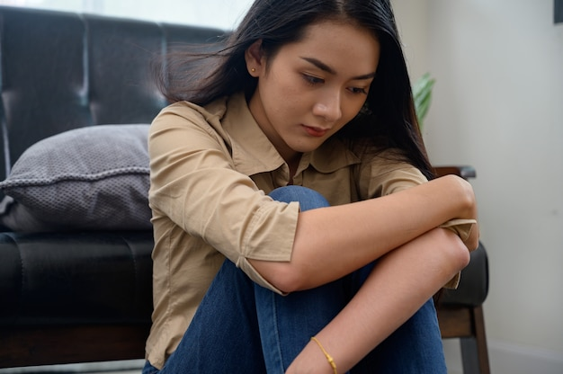Sad lonely depressed asian woman on at home