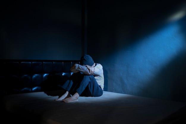 Sad man in the dark room