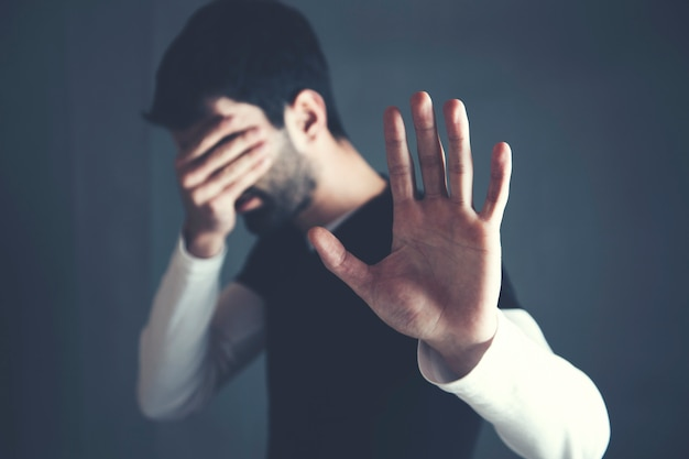 Sad man hand stop or no sign