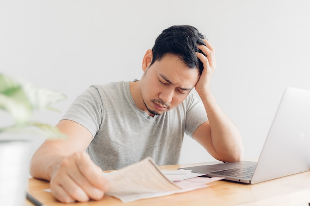 Sad man has problems with billing and debts.