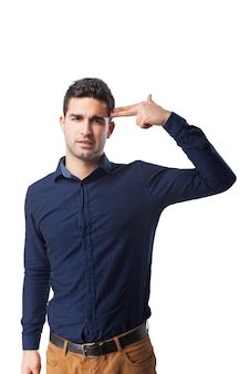 Sad man showing gun gesture with his hand