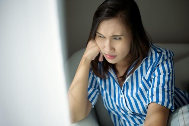 The sad pensive woman at home.