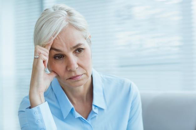 Sad senior woman at home