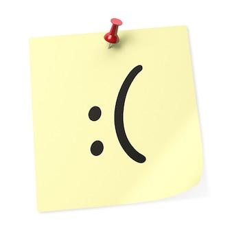 赤い押しピンが付いた「悲しい笑顔」の黄色い付箋。 3dレンダリング