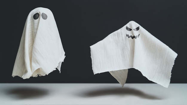 Sad and spiteful ghosts fly halloween holiday