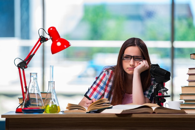 Sad student preparing for chemistry exams