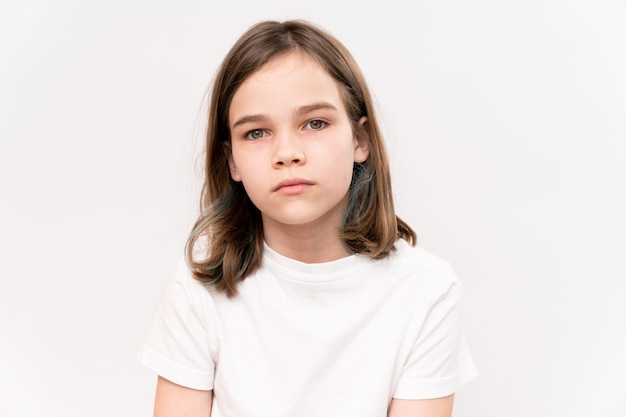Sad teenage girl in white t-shirt. child psychologist. to help children and adolescents in crisis situations.
