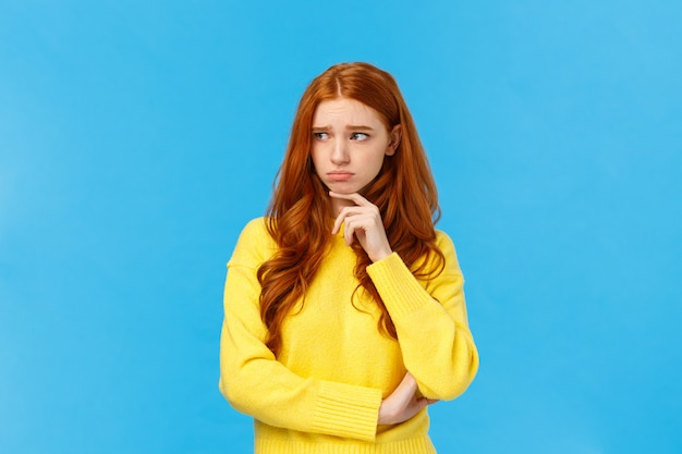 Sad timid and lonely redhead woman too feeling let down and depressed, sulking looking upset