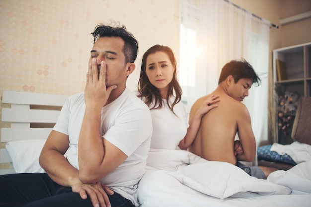 Sad woman change guy she have many boyfriend talking in bedroom