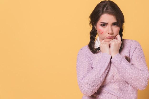 Sad woman posing while frowning