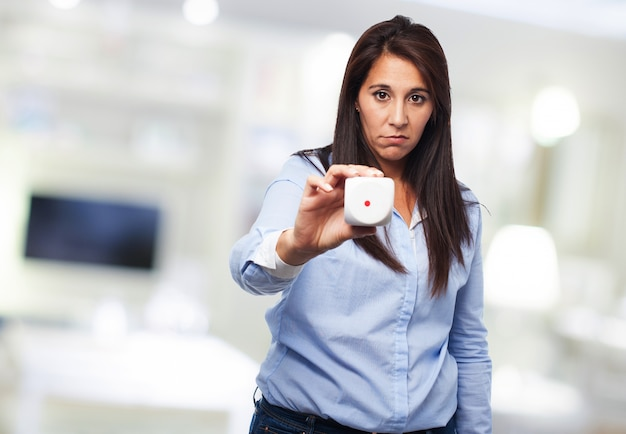 Sad woman teaching a die with number one face