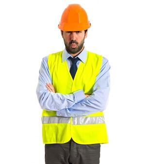 Sad worker over white background