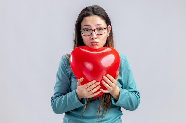 Sad young girl on valentines day holding heart balloon isolated on white background