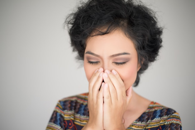 Sad young  woman cry with palm to face