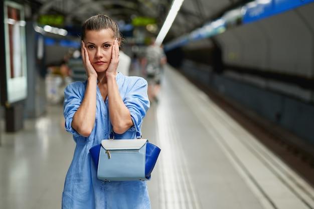Sad young woman portrait inside metro subway.