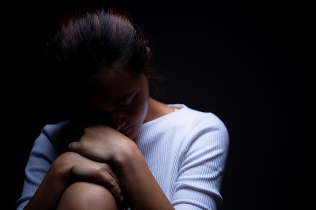 Sadness of a woman in the dark