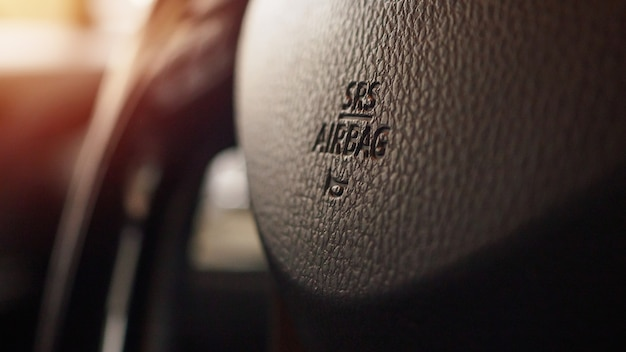 Safety airbag sign on car steering wheel with horn icon