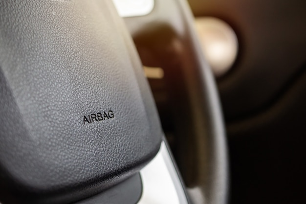 Safety airbag sign on car steering wheel