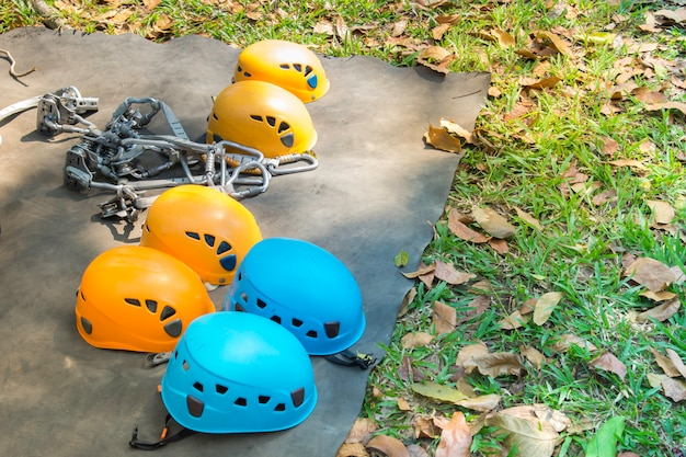 Safety belts with carbines and helmet. obstacle course equipment for outdoor activity and sport.
