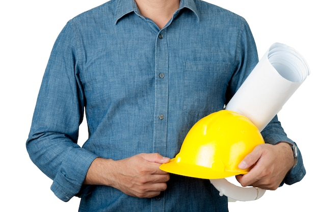 Safety concept. architecture wear blue shirt and hold yellow safety helmet and blue print