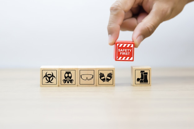 Safety and emergency graphics icons on wooden blocks.