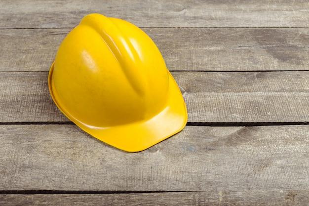 Safety engineer helmet gear on top of brown wooden table