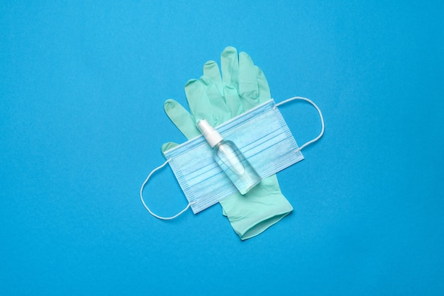 コロナウイルスcovid-19ウイルスの発生と戦うための安全装置-安全マスク、手指消毒剤、ラテックス手袋、保護メガネまたはゴーグル。
