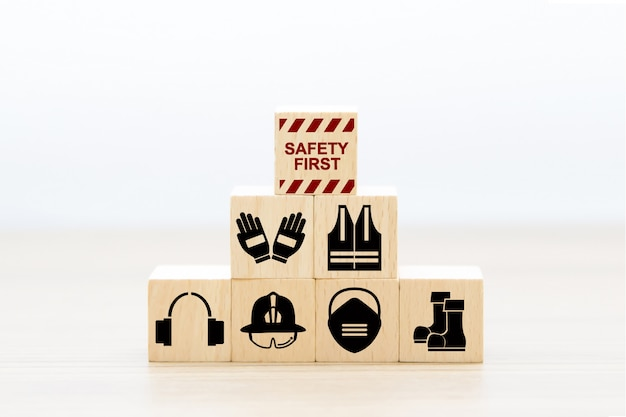Safety first icons on wood block stacking.