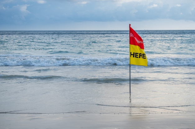 Safety flag swimming here on the beach.