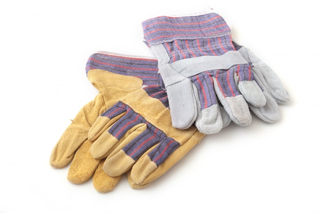 Safety gloves on white surface. protective worker gloves.
