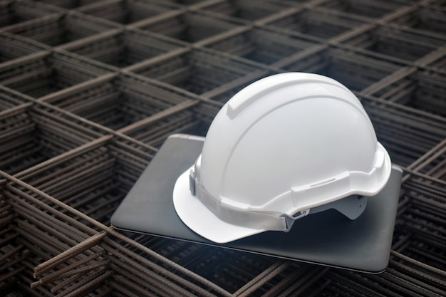 Safety hard hat on computer
