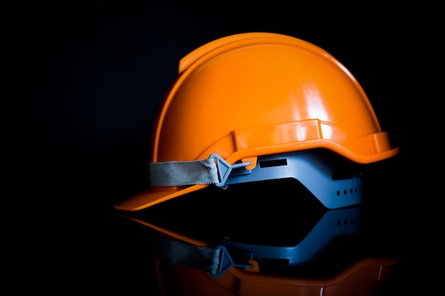 Safety helmet black backgrounds are used by engineers and industry and construction