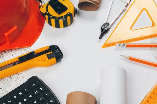 Safety helmet and scrolls of engineering drawings and supplies