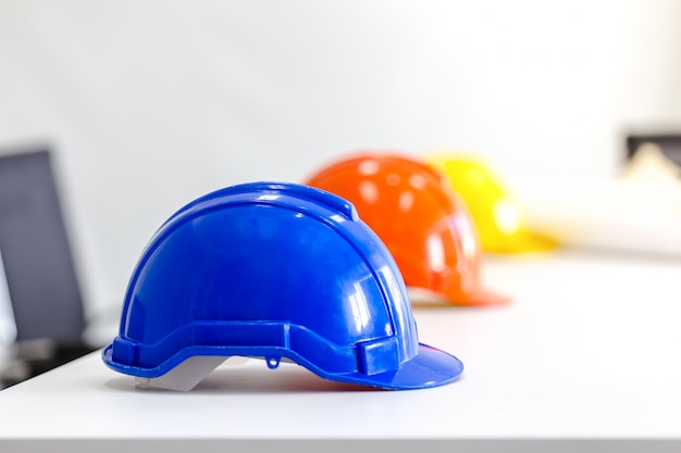 Safety helmet on table in office, engineer concept teamwork of building construction